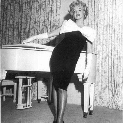 The Scandalous White Grand Piano