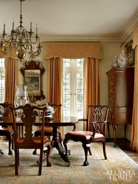 Cool A tall case clock and Queen Anne tea table accent the sweeping staircase The chandelier is from Edgar Reeves