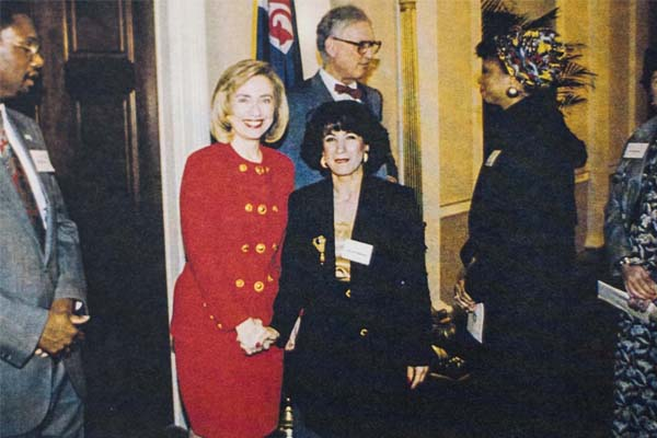 6612440238 Hilary Clinton in a bespoke suit by Jamileh Kamran with the designer in the  White House