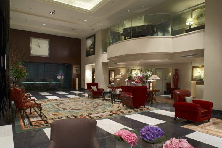 The warm and buzzy lobby at Sofitel London St. James