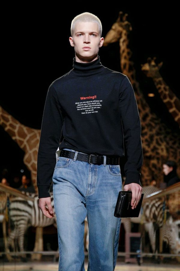 The show was set in the stunning Grande Galerie de l Évolution resulting in  wildlife serving as a backdrop to Vetements  quite sinister AW19 collection. 50fcdc7e662