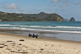 Surfing at Whangapoua
