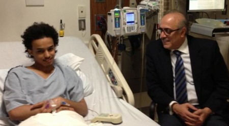 """Azzam bin Abdel Karim visiting the """"person of interest"""" in the hospital just prior to his deportation decision"""
