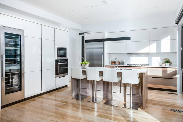 The kitchen has imported Italian cabinets and built-in appliances.