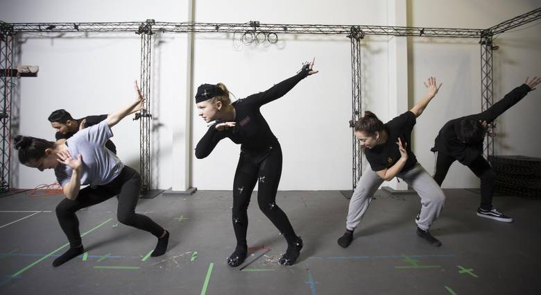 Boileau and Maya's background dancers rehearse their performance.