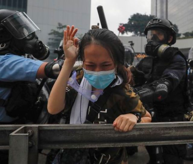 A Protester Reacts As She Tackled By Riot Police During A Massive Demonstration Outside The Legislative Council In Hong Kong Wednesday June 12 2019