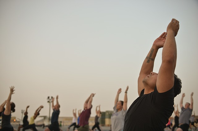 men yoga classes gym instructor hatha yoga professor posture person morale wellness hobbies relaxation stretching sporty sports body and spirit harmony fitness practicing yoga gymnastics serenity zen attitude outdoor sports young woman young man people gym gym gym gym gym wellness stretching fitness fitness