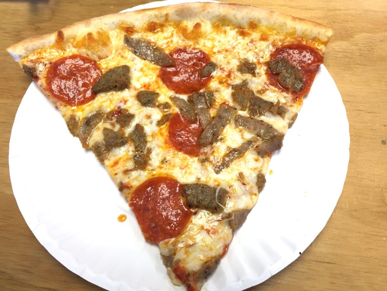 A slice ($3.50) with sausage and pepperoni