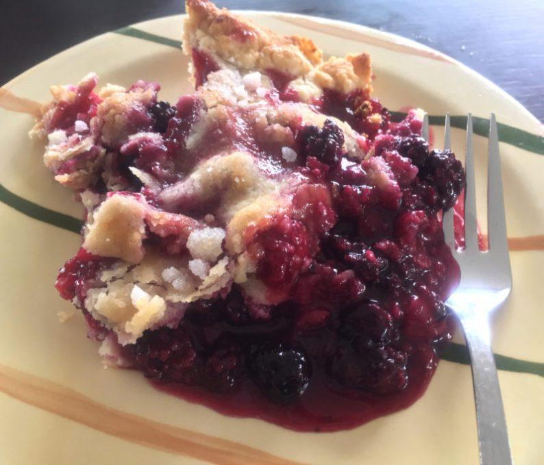 Serving of blackberry deep-dish cobbler