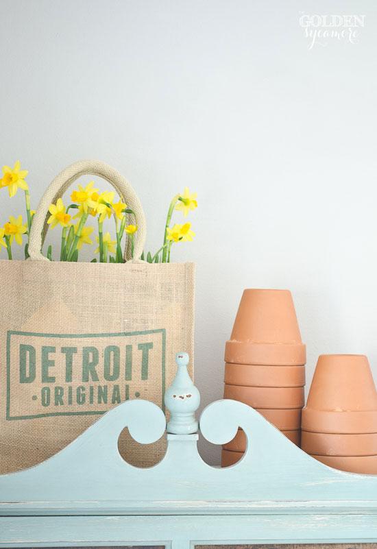 pretty yellow daffodils in burlap bag