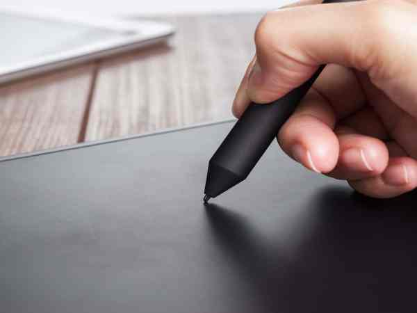 21070497 – hand of the designer with a pen on tablet