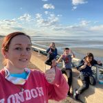Kat wasabi next to nantasket beach with her three teenaged children all giving the thumbs up