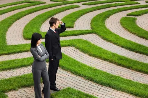 business man and woman corporate maze