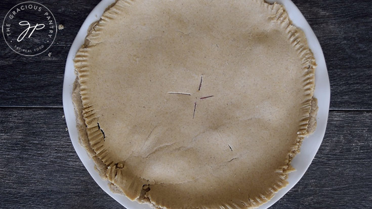 The crust edges, pinched for baking.