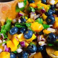 An up close shot of this Blueberry Mango Salsa in a mixing bowl.