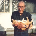 William S. Burroughs holding his cat Ginger