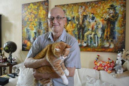 Leonid Afremov with his cat