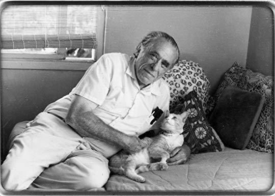Charles Bukowski with his cat Beeker