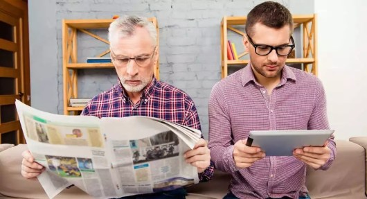 Older man and young man reading