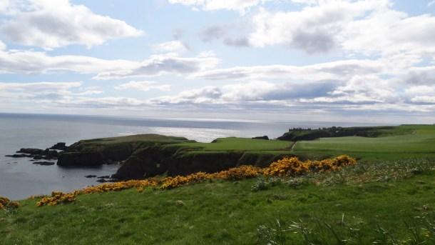 Green hills and cliffs