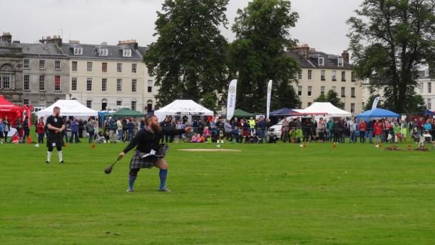 Perth Highland Games, man in kilt throwing something heavy