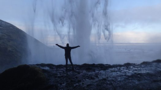 Getting soaked behind Seljalandsfoss waterfall