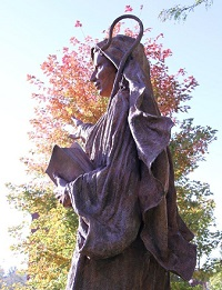 11. The Benedictine Sisters of Mount Saint Scholastica Monastery in Atchison commissioned a statue by Bill Hopen of St. Scholastica for their sesquicentennial. The statue was unveiled on October 17, 2014, in front of Elizabeth Hall on Benedictine's campus.