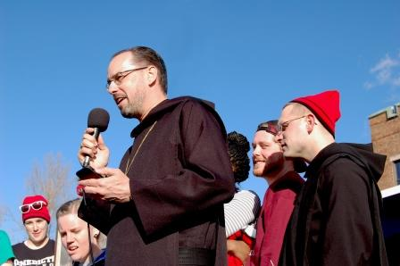 Abbot James Albers leads March for Life travelers in the traditional E-I-E-I-O cheer.