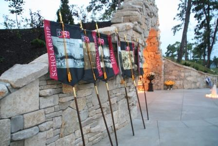 Banners rest on the Grotto wall after the ceremony. (Photo by Megan Bickford)
