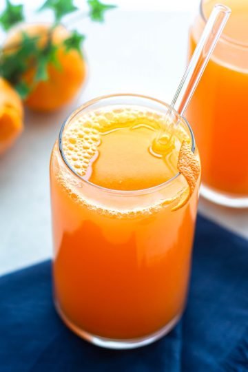 orange ginger juice in a glass