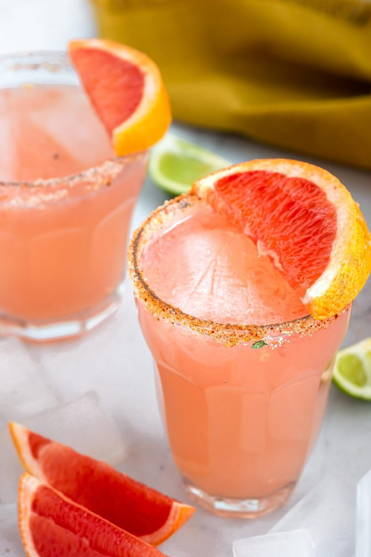 paloma cocktail in a glass with grapefruit slice on top