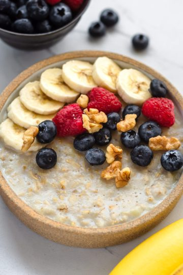 vegan microwave oatmeal in a bowl with fruits