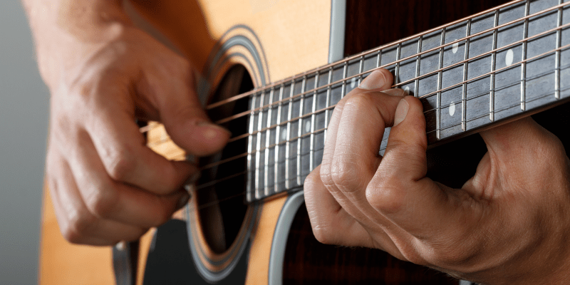 Fingers Plucking Guitar