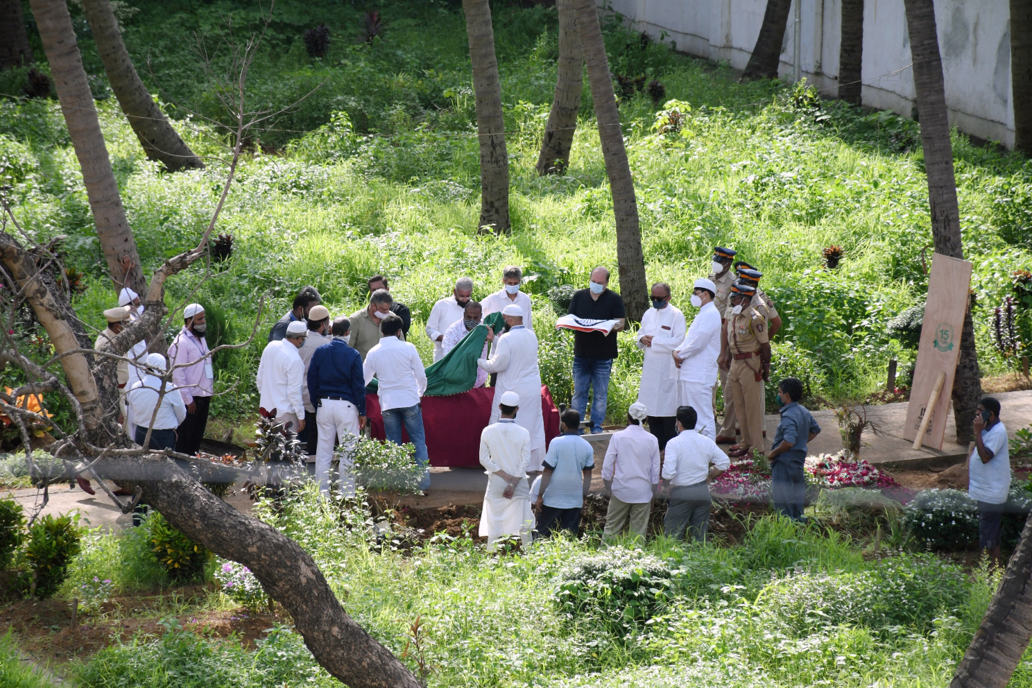Family and friends of veteran actor Dilip Kumar participate in his burial