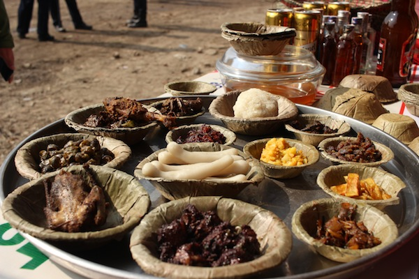 Set of Tharu dishes served on leaf plates (duna/tapari)