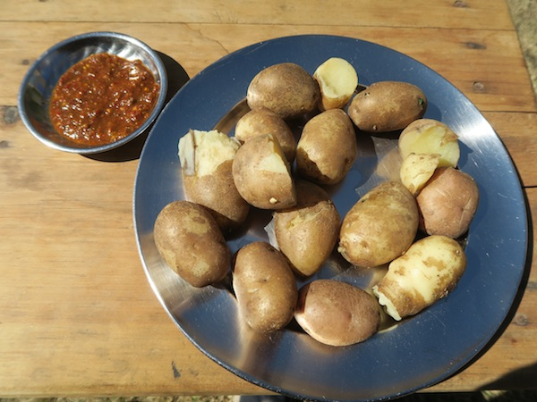 boiled potatoes with chili timur achaar at Kagani