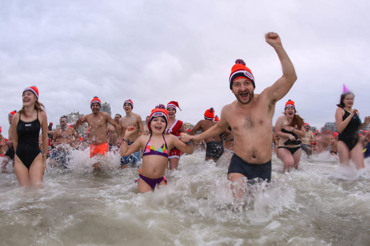 60,000 dive heroes enter the cold water during the 60th New Year's Dive