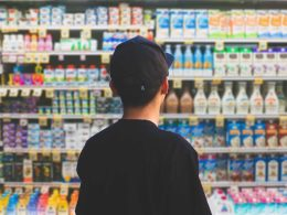 Man at the milk aisle in supermarket