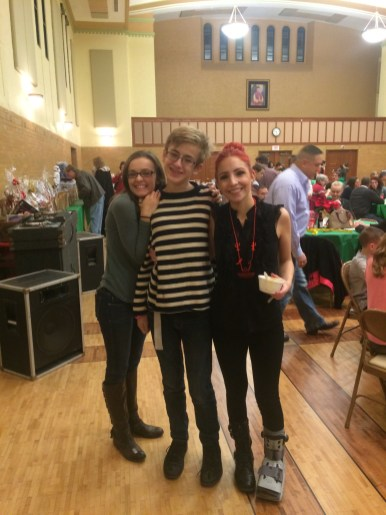 Joey Berger with HALO employees Sarah Kurtz and Mary Spickler