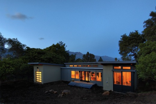 Santa-Barbara-prefab-by-Stillwater-Dwellings-evening-west-elevation-illuminated-at-sunset