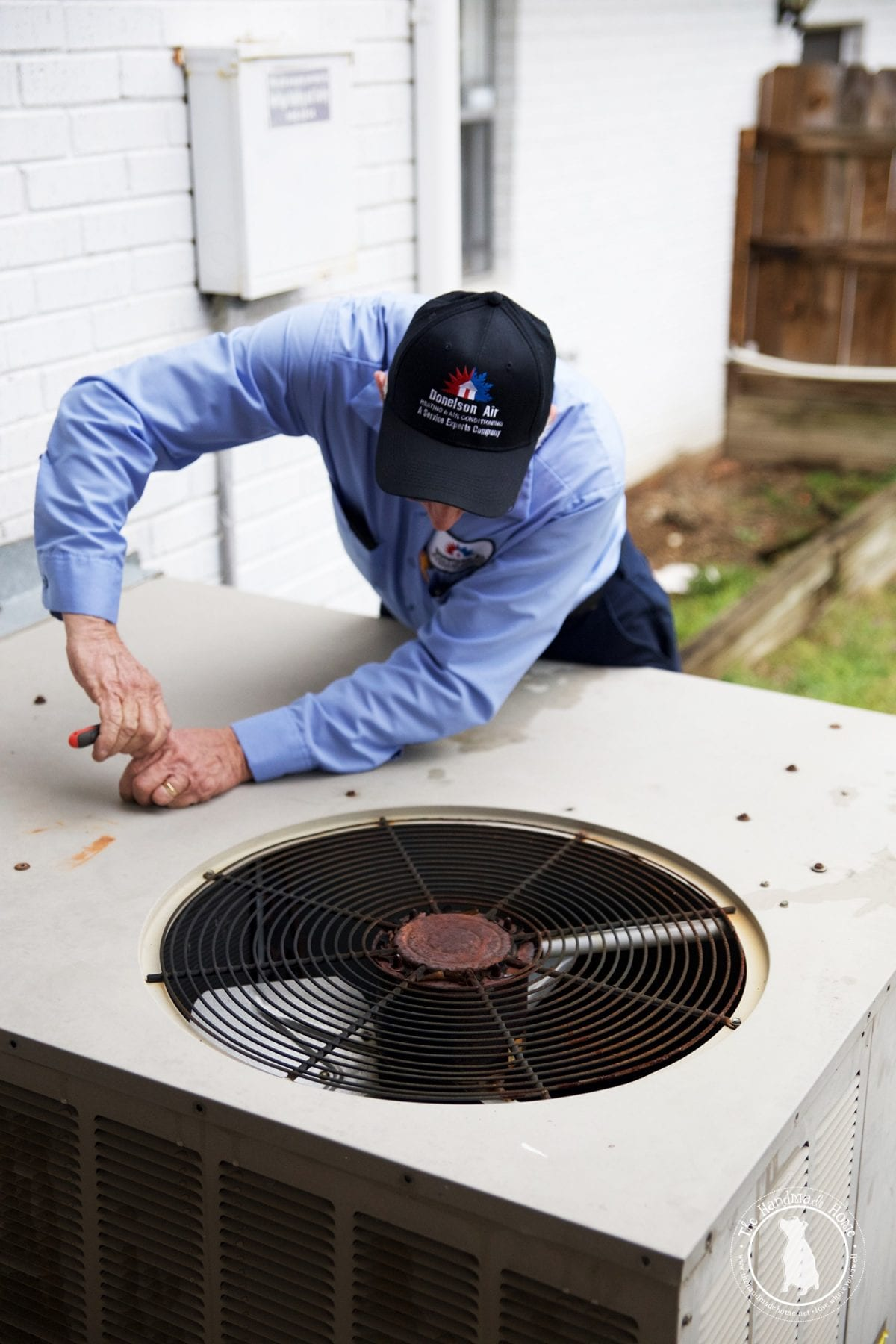 inspecting_an_old_unit_HVAC