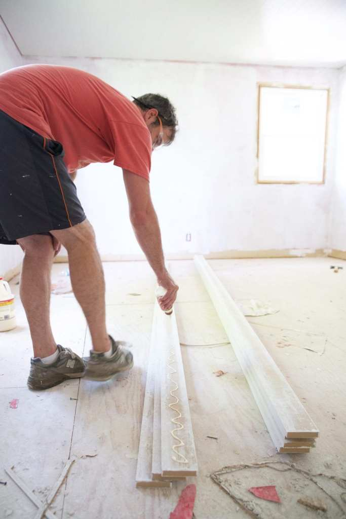 how to shiplap your ceiling - glue and paint