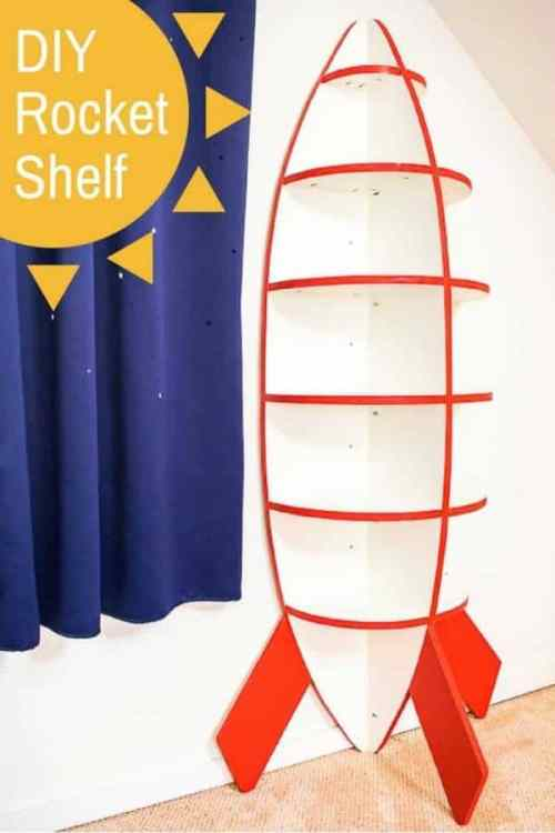This rocket bookshelf is perfect for a space themed bedroom! Easy to make with just one sheet of plywood. Get the free woodworking plans and tutorial at The Handyman's Daughter! | rocket shelves | spaceship shelves | spaceship bookshelf | kids room idea | space theme | kids themed room | outer space kids room
