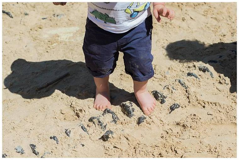 boy with his toes in the sandpit