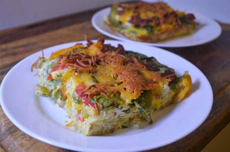 A delicious jam-packed breakfast casserole with hash browns, eggs, vegetables and turkey bacon. Gluten-free, grain-free