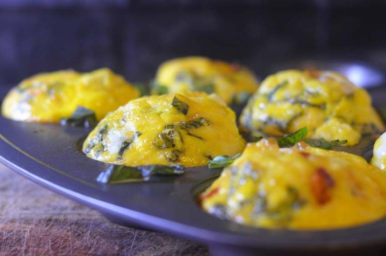 Mediterranean egg cups with feta, basil and sundried tomatoes. Gluten-free, grain-free, low-carb, keto