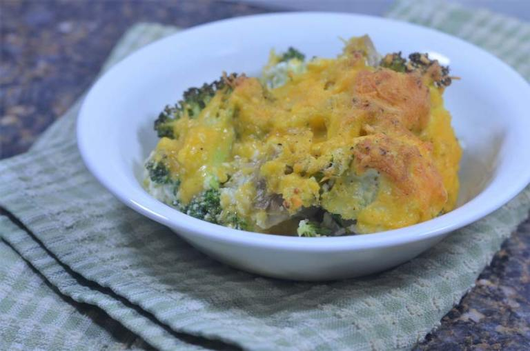 This cheddar broccoli chicken casserole is made with broccoli, cauliflower rice, chicken, sour cream butter and lots of shredded cheddar cheese. Gluten-free, grain-free, low-carb, and ketogenic.
