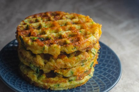 Savory cheddar zucchini waffles made using cheddar cheese, shredded zucchini and coconut flour. Super simple and delicious. Gluten-free, grain-free, low-carb, ketogenic.