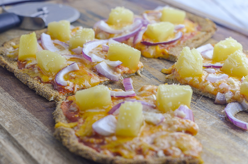 A pizza crust made of coconut flour that is so easy to prepare and delicious to eat. This coconut flour pizza crust can be made into either a thin crispy crust, or a thicker fluffy crust. It is completely gluten-free, grain-free, low-carb and ketogenic. It can easily be adapted for Paleo and dairy-free as well.