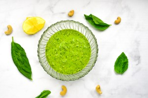 An incredibly simple and delicious dairy-free pesto made with cashews, fresh basil, lemon, garlic and olive oil. A fresh and zesty addition to your favorite Italian dish! Whole30 compliant, paleo, vegan, low-carb.